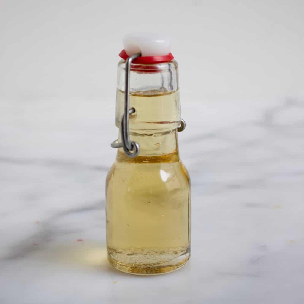 flesje met trempeersiroop