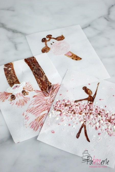 Drie tekeningen gemaakt door  het schilderen met chocolade in melk, wit, puur en ruby chocolade. Een ballerina, giraffe en een struisvogel